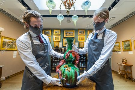A Burmantofts Faience Green-Glazed Double Gourd Vase, 1885, NO.676, EstimateGBP 2,000 - GBP 3,000 with other items - An Aesthetic Odyssey - The Peter Rose and Albert Gallichan Collection, at Christies King Street, London. It will be offered for sale in a live auction on 30 September 2021. The couple were pioneering collectors of 19th Century fine and decorative arts and this collection was assembled over the course of a lifetime from the 1950s onwards. Ensuring that the scholarly legacy of their life's work lives on, the proceeds from the sale  - which is expected to realise in excess of £1 million, with estimates starting from £500 - will benefit The Albert Dawson Educational Trust.