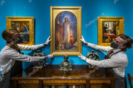 Stock Picture of William Holman Hunt's masterpieceThe Light of the World (C estimate: £60,000-100,000) - An Aesthetic Odyssey - The Peter Rose and Albert Gallichan Collection, at Christies King Street, London. It will be offered for sale in a live auction on 30 September 2021. The couple were pioneering collectors of 19th Century fine and decorative arts and this collection was assembled over the course of a lifetime from the 1950s onwards. Ensuring that the scholarly legacy of their life's work lives on, the proceeds from the sale  - which is expected to realise in excess of £1 million, with estimates starting from £500 - will benefit The Albert Dawson Educational Trust.