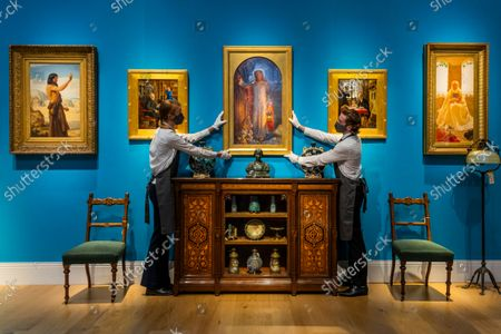 Stock Photo of William Holman Hunt's masterpieceThe Light of the World (C estimate: £60,000-100,000) - An Aesthetic Odyssey - The Peter Rose and Albert Gallichan Collection, at Christies King Street, London. It will be offered for sale in a live auction on 30 September 2021. The couple were pioneering collectors of 19th Century fine and decorative arts and this collection was assembled over the course of a lifetime from the 1950s onwards. Ensuring that the scholarly legacy of their life's work lives on, the proceeds from the sale  - which is expected to realise in excess of £1 million, with estimates starting from £500 - will benefit The Albert Dawson Educational Trust.