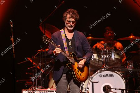 Stock Picture of Doyle Bramhall II with Eric Clapton Performs at Gas South Arena, in Atlanta