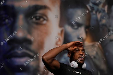 Britain's Anthony Joshua poses during the weigh for his heavyweight boxing match against Oleksandr Usyk of the Ukraine at the O2 Arena in London, . Joshua the Heavyweight WBA (Super), WBO and IBF champion will defend his titles against former cruiserweight champion Usyk, on Saturday, at Tottenham Hotspurs White Hart Lane stadium