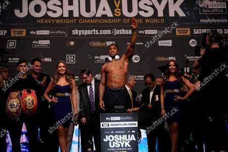 Britain's Anthony Joshua salutes his fans as he weighs in ahead of his upcoming heavyweight boxing match against Oleksandr Usyk of the Ukraine, at the O2 Arena in London, . Joshua the Heavyweight WBA (Super), WBO and IBF champion will defend his titles against former cruiserweight champion Usyk, on Saturday, at Tottenham Hotspurs White Hart Lane stadium