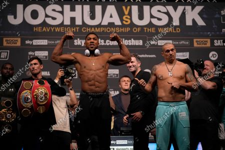 Britain's Anthony Joshua, left, and Oleksandr Usyk of the Ukraine pose for the media during the weigh-in for their upcoming heavyweight boxing match at the O2 Arena in London, . Joshua the Heavyweight WBA (Super), WBO and IBF champion will defend his titles against former cruiserweight champion Usyk, on Saturday, at Tottenham Hotspurs White Hart Lane stadium
