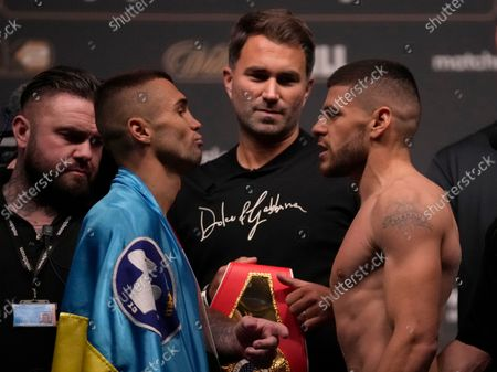 Florian Marku of Albania, right, faces Maxim Prodan, of the Ukraine during the official weigh in ahead of their upcoming boxing match, at the O2 Arena in London, . Florian Marku of Albania and Maxim Prodan of the Ukraine will fight as part of the undercard to the Anthony Joshua of Britain and Ukraine's Oleksandr Usyk, Heavyweight match for the WBA (Super), WBO and IBF titles on Saturday, at Tottenham Hotspurs White Hart Lane stadium
