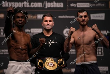 Christopher Ousley of the United States, left, and Khasan Baysangurov of Ukraine at the weigh in ahead of their upcoming boxing match, at the O2 Arena in London, . Baysangurov and Ousley will fight as part of the undercard to the Anthony Joshua of Britain and Ukraine's Oleksandr Usyk, Heavyweight match for the WBA (Super), WBO and IBF titles on Saturday, at Tottenham Hotspurs White Hart Lane stadium