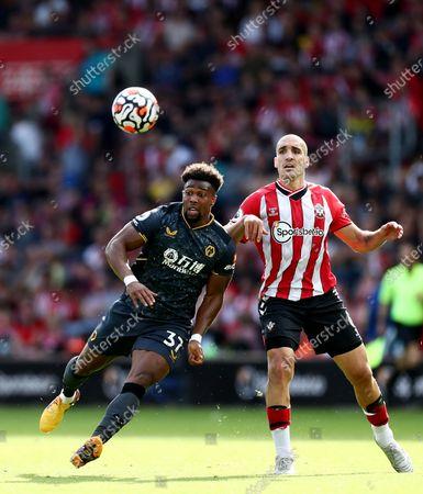 Adama Traore of Wolverhampton Wanderers and Oriol Romeu of Southampton.