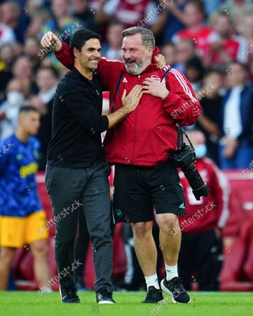 Stock Picture of Arsenal manager Mikel Arteta celebrates at full time with club photographer Stuart MacFarlane