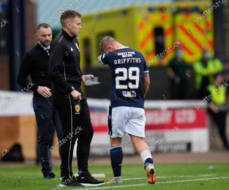 Leigh Griffiths of Dundee limps off the pitch during the first half to be substituted for Jason Cummings of Dundee