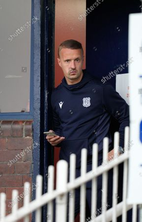 Leigh Griffiths of Dundee looks out fro the Dundee players area after the final whistle. Griffiths limped off the pitch and was replaced by Jason Cummings during the first half of the match.