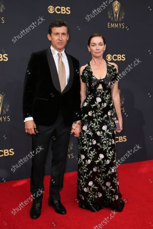 Stock Picture of Jonathan Cake, left, and Julianne Nicholson arrive at the 73rd Emmy Awards at the JW Marriott on at L.A. LIVE in Los Angeles