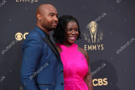 Robert Sweeting and Uzo Aduba arrive at the 73rd Emmy Awards at the JW Marriott on at L.A. LIVE in Los Angeles