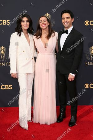 Stock Picture of Jen Statsky, Lucia Aniello and Paul W. Downs arrive at the 73rd Emmy Awards at the JW Marriott on at L.A. LIVE in Los Angeles
