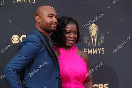 Stock Image of Robert Sweeting and Uzo Aduba arrive at the 73rd Emmy Awards at the JW Marriott on at L.A. LIVE in Los Angeles