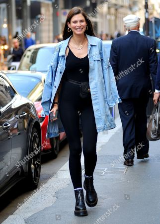 Bianca Balti, the splendid Italian supermodel, strolls through the streets after having paraded in the morning and goes to lunch.