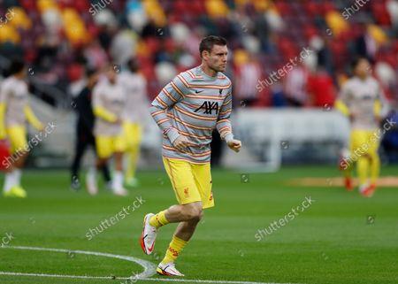 James Milner of Liverpool warming up; Brentford Community Stadium, London, England; Premier League Football Brentford versus Liverpool.