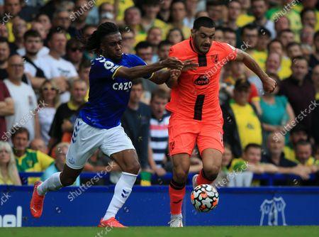 Ozan Kabak of Norwich City fends off Alex Iwobi of Everton; Goodison Park, Liverpool, England; Premier League football, Everton versus Norwich.