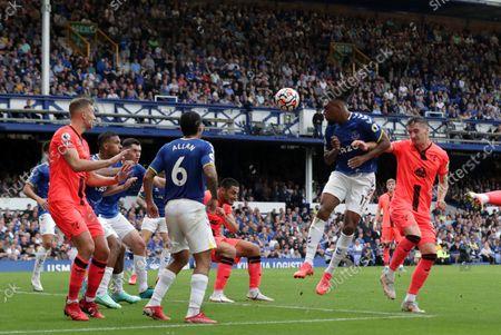 Alex Iwobi of Everton wins a defensive header to clear his box; Goodison Park, Liverpool, England; Premier League football, Everton versus Norwich.