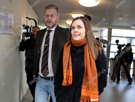 Iceland's Prime Minister Katrin Jakobsdottir, right, arrives at a polling station in Reykjavik, Iceland, . Icelanders are voting in a general election dominated by climate change, with an unprecedented number of political parties likely to win parliamentary seats