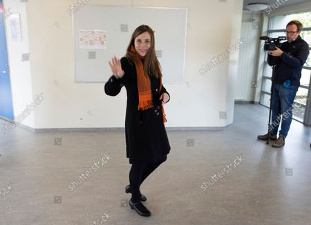Iceland's Prime Minister Katrin Jakobsdottir leaves after voting at a polling station in Reykjavik, Iceland, . Icelanders are voting in a general election dominated by climate change, with an unprecedented number of political parties likely to win parliamentary seats