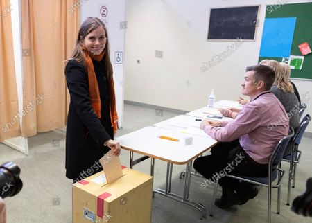 Iceland's Prime Minister Katrin Jakobsdottir casts her vote at a polling station in Reykjavik, Iceland, . Icelanders are voting in a general election dominated by climate change, with an unprecedented number of political parties likely to win parliamentary seats
