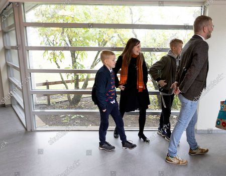 Iceland's Prime Minister Katrin Jakobsdottir leaves with her family after voting at a polling station in Reykjavik, Iceland, . Icelanders are voting in a general election dominated by climate change, with an unprecedented number of political parties likely to win parliamentary seats