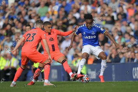 Norwich City midfielder Kenny McLean  (23)  Norwich City defender Max Aarons  (2) and Everton midfielder Alex Iwobi (17) battles for possession during the Premier League match between Everton and Norwich City at Goodison Park, Liverpool