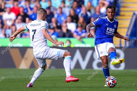 Ryan Bertrand of Leicester City gets the ball past Johann Gudmundsson of Burnley