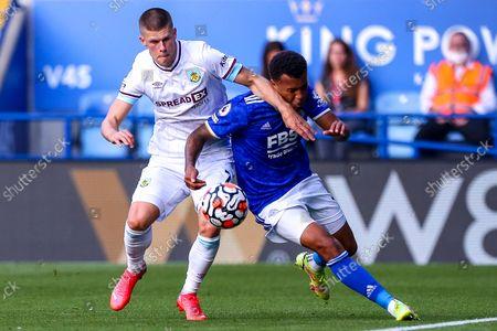 Johann Gudmundsson of Burnley challenges Ryan Bertrand of Leicester City for possession