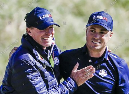 US Team Captain Steve Stricker (L) and US team member Justin Thomas react on the eighteenth green during Foursomes matches on the second day of the pandemic-delayed 2020 Ryder Cup golf tournament at the Whistling Straits golf course in Kohler, Wisconsin, USA, 24 September 2021. Competition for the 43rd Ryder Cup between the US and Europe began 24 September 2021.