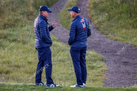 US Team Captain Steve Stricker (L) speaks with US Team Vice captain Jim Furyk (R) at the first hole during foursomes matchs in the pandemic-delayed 2020 Ryder Cup golf tournament at the Whistling Straits golf course in Kohler, Wisconsin, USA, 25 September 2021.