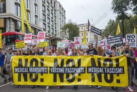 Participants gather and march during a Medical Freedom March in central London, Saturday, 25 September 2021.  The demonstrators are against the government's 'Plan B' of Covid-19 measures such as vaccine passports, masks and working from home to protect the NHS (National Health Service).