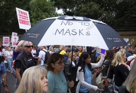 Stock Picture of Participants gather and march during a Medical Freedom March in central London, Saturday, 25 September 2021.  The demonstrators are against the government's 'Plan B' of Covid-19 measures such as vaccine passports, masks and working from home to protect the NHS (National Health Service).