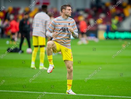 James Milner of Liverpool warms up before the start of the game at Brentford