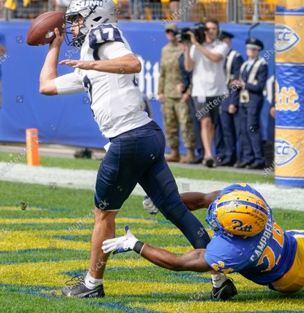 New Hampshire quarterback Bret Edwards (17) tries to get a pass off as Pittsburgh linebacker Phil Campbell III (24) grabs his legs in the end zone during the first half of an NCAA college football game, in Pittsburgh. Edwards was flagged for intentional grounding on the play awarding Pittsburgh a safety