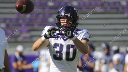 Wide receiver Drew Scott (30) catches a pass during warmups before an NCAA football game against Southern Methodist University, in Fort Worth, Texas