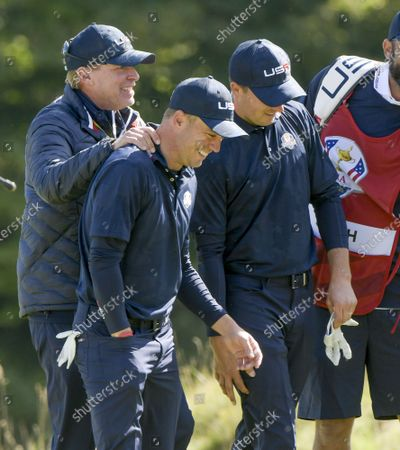 Team USA's Captain, Steve Stricker congratulates Justin Thomas and Jordan Spieth on their match win in the 43rd Ryder Cup at Whistling Straits on Saturday, September 25, 2021 in Kohler, Wisconsin.