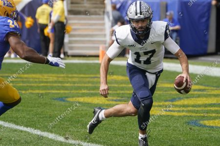 New Hampshire quarterback Bret Edwards (17) looks to pass as Pittsburgh linebacker Phil Campbell III (24)I chases him in an NCAA college football game against Pittsburgh, in Pittsburgh