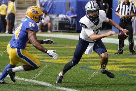 Stock Picture of New Hampshire quarterback Bret Edwards (17) looks to pass as Pittsburgh linebacker Phil Campbell III (24)I chases him in an NCAA college football game against Pittsburgh, in Pittsburgh