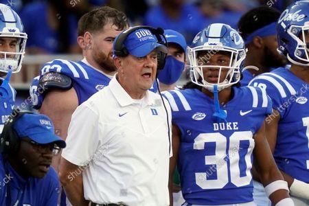 Duke head coach David Cutcliffe looks on with Duke safety Brandon Johnson (30) during the second half of an NCAA college football game against Kansas in Durham, N.C