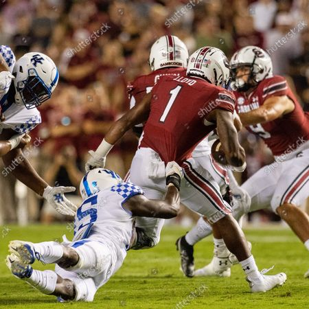 Stock Photo of Kentucky Wildcats linebacker Jordan Wright (15) grabs South Carolina Gamecocks running back MarShawn Lloyd (1) in the backfield in the second quarter of the SEC matchup at Williams-Brice Stadium in Columbia, SC
