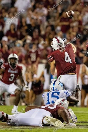 Kentucky Wildcats linebacker Jordan Wright (15) hits South Carolina Gamecocks quarterback Luke Doty (4) as he throws in the fourth quarter of the SEC matchup at Williams-Brice Stadium in Columbia, SC