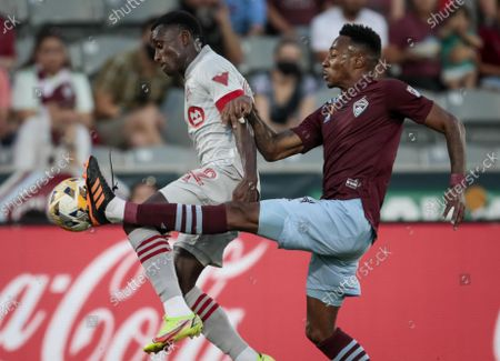 Stock Image of Toronto FC midfielder Richie Laryea (22) leaps for the ball against Colorado Rapids midfielder Mark-Anthony Kaye in the first half of an MLS soccer game in Denver