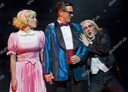 Stock Image of Lucy Maunder as Janet, Alex Rathgeber as Brad and Kristian Lavercombe as Riff Raff