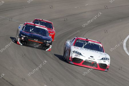 Stock Picture of LAS VEGAS MOTOR SPEEDWAY, UNITED STATES OF AMERICA - SEPTEMBER 25: #26: Dylan Lupton, Sam Hunt Racing, Toyota Supra Marques General Engineering, #44: Tommy Joe Martins, Martins Motorsports, Chevrolet Market Rebellion at Las Vegas Motor Speedway on Saturday September 25, 2021 in Las Vegas, United States of America. (Photo by LAT Images)