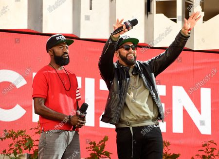 The Kid Mero, left, and Desus Nice speak at Global Citizen Live in Central Park, in New York