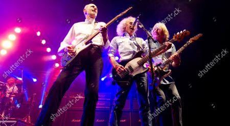 Francis Rossi, Alan Lancaster and Rick Parfitt of  -  Status Quo  - John Coghlan (LEFT - drums)