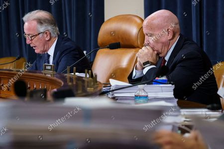 House Ways and Means Committee Chairman Richard Neal, D-Mass., left, and Rep. Kevin Brady, R-Texas, the ranking member, right, make opening statements as the tax-writing panel continues work on the Democrats' proposal for tax hikes on big corporations and the wealthy to fund President Joe Biden's $3.5 trillion domestic rebuilding plan, at the Capitol in Washington