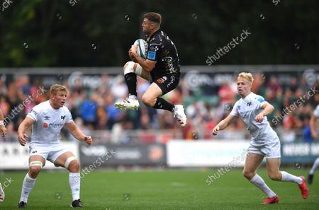 Josh Lewis of Dragons takes high ball.