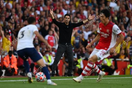 Manager Mikel Arteta (C) of Arsenal reacts during the English Premier League soccer match between Arsenal FC and Tottenham Hotspur in London, Britain, 26 September 2021.