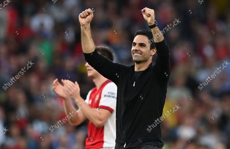 Manager Mikel Arteta of Arsenal celebrates after winning the match against Tottenham during the English Premier League soccer match between Arsenal FC and Tottenham Hotspur in London, Britain, 26 September 2021.